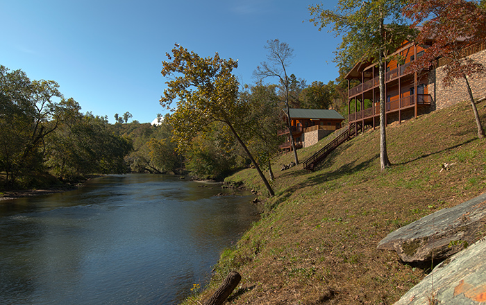 View Of Two Neighboring Hiwassee River Cabins Shot From River Retreat
