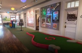 2nd Story Entertainment | Cabin Rentals of Georgia | Indoor Massive Putt putt with Themed Rooms