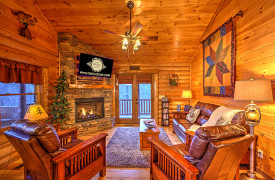 Blue Ridge Lakewalk | Blue Ridge Luxury Cabin Rentals | Cabin Rentals of Georgia | Cozy Living Area w/ leather furnishings, fireplace, and TV