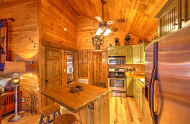 Blue Ridge Lakewalk | Blue Ridge Luxury Cabin Rentals | Cabin Rentals of Georgia | Queen Bedroom on main level w/ 4-poster bed and access to porch