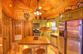 Blue Ridge Lakewalk | Blue Ridge Luxury Cabin Rentals | Cabin Rentals of Georgia | Fully-stocked kitchen w/ stainless steel appliances and custom cabinetry