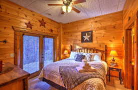 Blue Ridge Lakewalk | Blue Ridge Luxury Cabin Rentals | Cabin Rentals of Georgia | King Master Suite w/ access to wraparound porch and ensuite bathroom