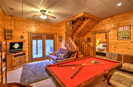 Blue Ridge Lakewalk | Blue Ridge Luxury Cabin Rentals | Cabin Rentals of Georgia | Game Room showing access to King master suite and outdoor hot tub