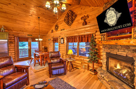 Blue Ridge Lakewalk | Blue Ridge Luxury Cabin Rentals | Cabin Rentals of Georgia | Living area w/ fireplace, TV and open to dining table