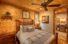 A Rustic Elegant Retreat | Blue Ridge Luxury Cabin Rentals | Cabin Rentals of Georgia | Queen bedroom looking into ensuite bath