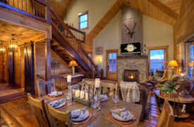A Rustic Elegant Retreat | Blue Ridge Luxury Cabin Rentals | Cabin Rentals of Georgia | Living and dining area w/ TV and fireplace