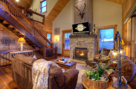 A Rustic Elegant Retreat | Blue Ridge Luxury Cabin Rentals | Cabin Rentals of Georgia |Luxury Living Area w/ leather furnishings, fireplace, and soft throws