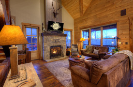A Rustic Elegant Retreat | Blue Ridge Luxury Cabin Rentals | Cabin Rentals of Georgia | Luxury Living room with leather furnishings, fireplace, TV, mountain views