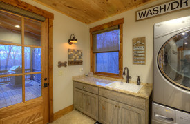 A Rustic Elegant Retreat | Blue Ridge Luxury Cabin Rentals | Cabin Rentals of Georgia | Laundry Room w/ sink and countertops, access to porch w/ gas grill