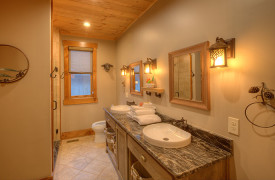 A Rustic Elegant Retreat | Blue Ridge Luxury Cabin Rentals | Cabin Rentals of Georgia | Queen bedroom ensuite bath with double vanity, shower