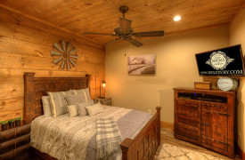 A Rustic Elegant Retreat | Blue Ridge Luxury Cabin Rentals | Cabin Rentals of Georgia | terrace level queen bedroom w/ TV