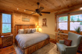 A Rustic Elegant Retreat | Blue Ridge Luxury Cabin Rentals | Cabin Rentals of Georgia | King Master Suite on Main level w/ wing back chair