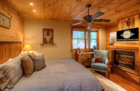 A Rustic Elegant Retreat | Blue Ridge Luxury Cabin Rentals | Cabin Rentals of Georgia | Main level king master suite w/ fireplace and TV