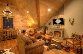 A Rustic Elegant Retreat | Blue Ridge Luxury Cabin Rentals | Cabin Rentals of Georgia | Luxury Loft w/ Fireplace, TV, leather furnishings, beautiful accessories