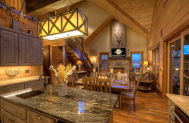 A Rustic Elegant Retreat | Blue Ridge Luxury Cabin Rentals | Cabin Rentals of Georgia | from the kitchen looking into dining and living area