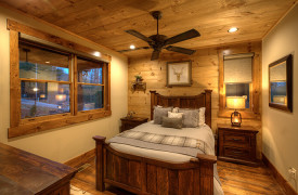 A Rustic Elegant Retreat | Blue Ridge Luxury Cabin Rentals | Cabin Rentals of Georgia | Queen bedroom with luxurious bedding