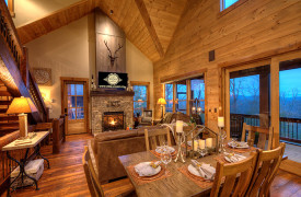 A Rustic Elegant Retreat | Blue Ridge Luxury Cabin Rentals | Cabin Rentals of Georgia | Luxury Living area and dining for 6 with mountain views at dusk