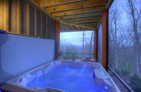A Rustic Elegant Retreat | Blue Ridge Luxury Cabin Rentals | Cabin Rentals of Georgia | terrace level hot tub and mountain views during winter