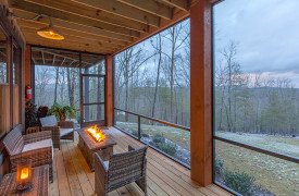 A Rustic Elegant Retreat | Blue Ridge Luxury Cabin Rentals | Cabin Rentals of Georgia | terrace level outdoor living w/ firetable and winter views