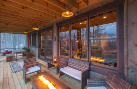 A Rustic Elegant Retreat | Blue Ridge Luxury Cabin Rentals | Cabin Rentals of Georgia | Terrace level outdoor living with seating and