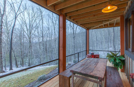 A Rustic Elegant Retreat | Blue Ridge Luxury Cabin Rentals | Cabin Rentals of Georgia | terrace level outdoor living alfresco dining and winter views