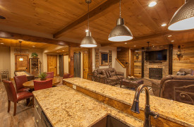 A Rustic Elegant Retreat | Blue Ridge Luxury Cabin Rentals | Cabin Rentals of Georgia | terrace level full kitchen w/ dining area and game room