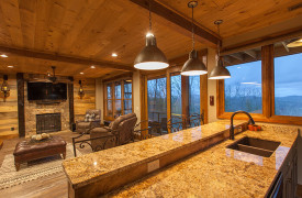 A Rustic Elegant Retreat | Blue Ridge Luxury Cabin Rentals | Cabin Rentals of Georgia | terrace level full kitchen w/ breakfast bar for 4