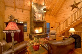 A Rolling River Cabin | Cabin Rentals of Georgia | Romantic Living Area and Cozy Fireplace