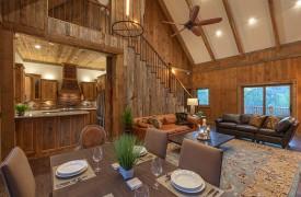 A Mayfly Lodge & Treehouse | Cabin Rentals of Georgia | Open Floor Plan to Living, Dining, and Kitchen
