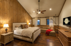 A Mayfly Lodge & Treehouse | Cabin Rentals of Georgia | King Suite Upstairs with TV and large sofa