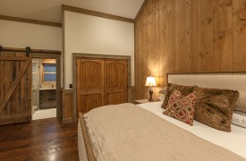 A Mayfly Lodge & Treehouse | Cabin Rentals of Georgia | Upstairs EnSuite Bath with barn doors