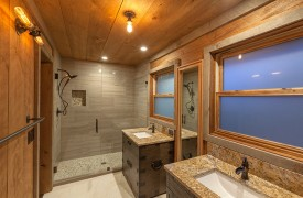 A Mayfly Lodge & Treehouse | Cabin Rentals of Georgia | Upper Master Bath with stone shower, separate vanities