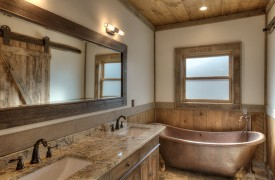 A Mayfly Lodge & Treehouse | Cabin Rentals of Georgia | King Suite Bath on Main Level with copper tub and double vanity