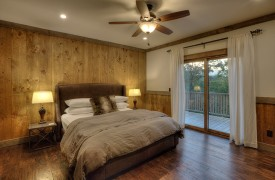A Mayfly Lodge & Treehouse | Cabin Rentals of Georgia | King Suite on Main Level with access to deck