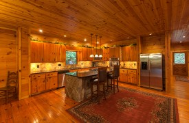 The River's Edge | Cabin Rentals of Georgia | Gourmet Kitchen w/ Large Cootop Island and Bar