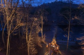 The River's Edge | Cabin Rentals of Georgia | Terrace Level Staircase Going Down to Octagonal Deck w/ Fireplace Overlooking Toccoa River