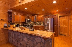 Bella Vista Lodge | Cabin Rentals of Georgia | Beautiful Stone Counter