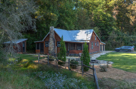 Cherokee Sunrise on Noontootla Creek | Cabin Rentals of Georgia | Landscaped Farmhouse