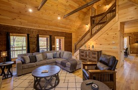 Our True Blue | Blue Ridge Cabin Rentals | Cabin Rentals of Georgia | Living Area looking into Kitchen/Dining Area