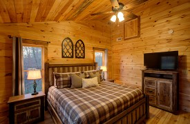 Our True Blue | Blue Ridge Cabin Rentals | Cabin Rentals of Georgia | Main level King Bedroom w/ luxury linens and TV