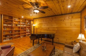 The River's Edge | Cabin Rentals of Georgia | Front Living Room w/ Bookshelves
