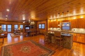 The River's Edge | Cabin Rentals of Georgia | Gourmet Kitchen Open to Dining and Living Areas