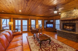 The River's Edge | Cabin Rentals of Georgia | Living Area w/ Fireplace and TV