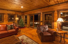 The River's Edge | Cabin Rentals of Georgia | Christmas Tree in Living Area