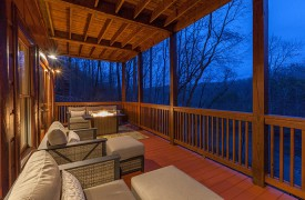 The River's Edge | Cabin Rentals of Georgia | Outdoor Living w/ Fire Table Overlooking Toccoa River