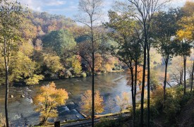 The River's Edge | Cabin Rentals of Georgia | Beautiful Autumn Foliage Along the Toccoa River and the Outdoor Fireplace
