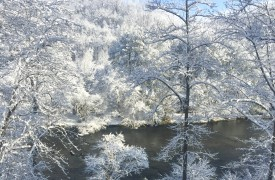 The River's Edge | Cabin Rentals of Georgia | Snowy Scene Along the Toccoa River and the Outdoor Fireplace