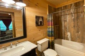Lazy Creek Retreat | Cabin Rentals of Georgia | Private Ensuite Bath to Second King Bedroom on Main Level
