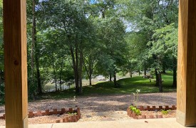 Lazy Creek Retreat | Cabin Rentals of Georgia | Terrace Level Porch overlooking Creek and Yard