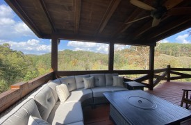 Fallen Timber Lodge | Cabin Rentals of Georgia | Main Deck Conversational Seating with Fire Table